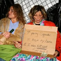 Legal firm Mocks foreclosures and people going homeless in its halloween party