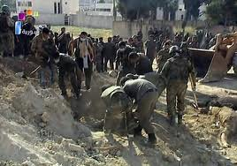 Horrors of war: Mass grave discovered in Damascus