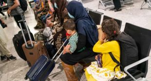 Shoeless, shivering, passing out: Afghan refugees arrive in the UK